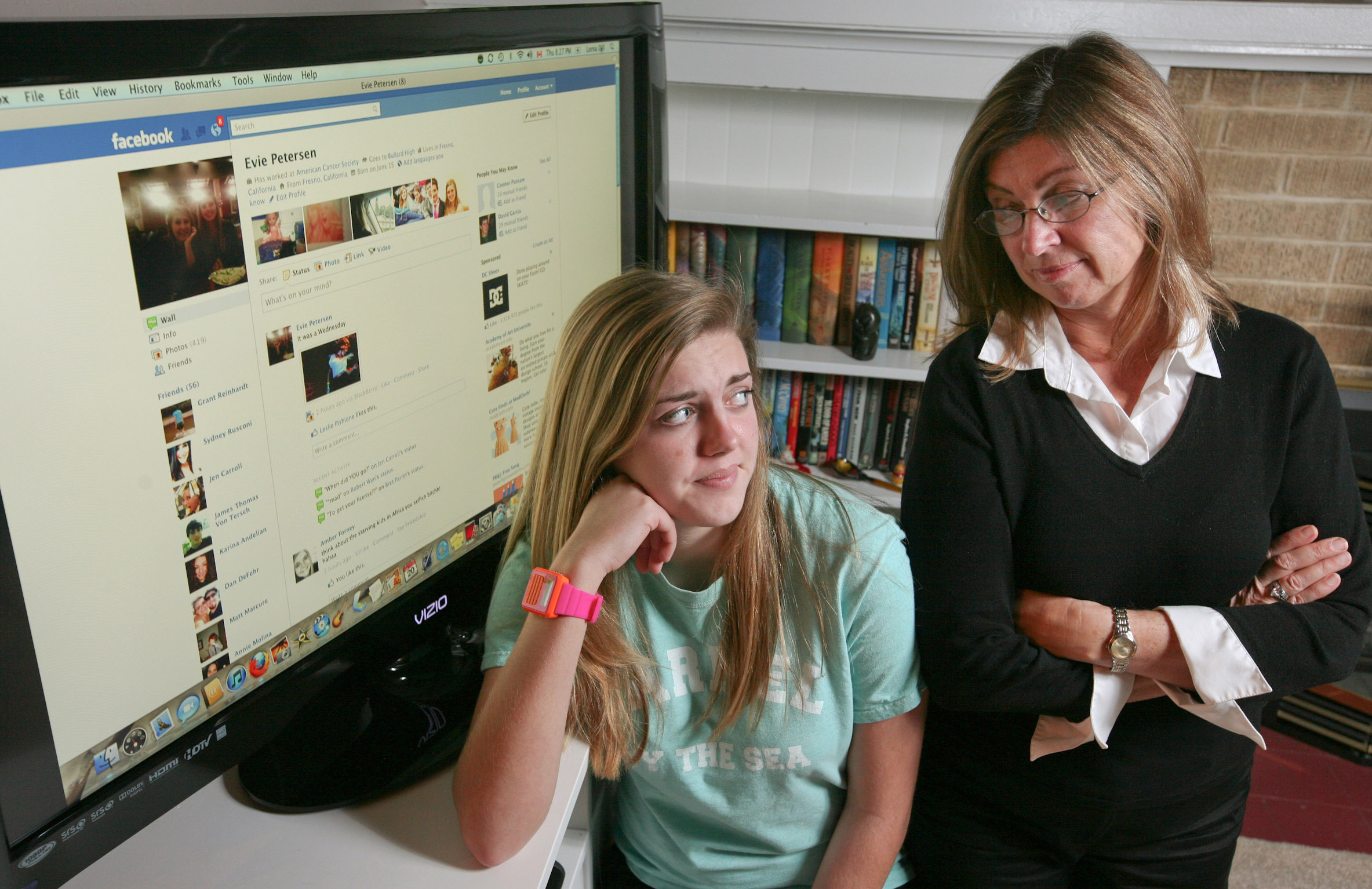 Evie Petersen, left, likes having friends on Facebook, but doesn't especially want her mother, Gretta Petersen, right, to be one of them. Evie has friended, unfriended, refriended and then unfriended her mom. (Craig Kohlruss/Fresno Bee/MCT)